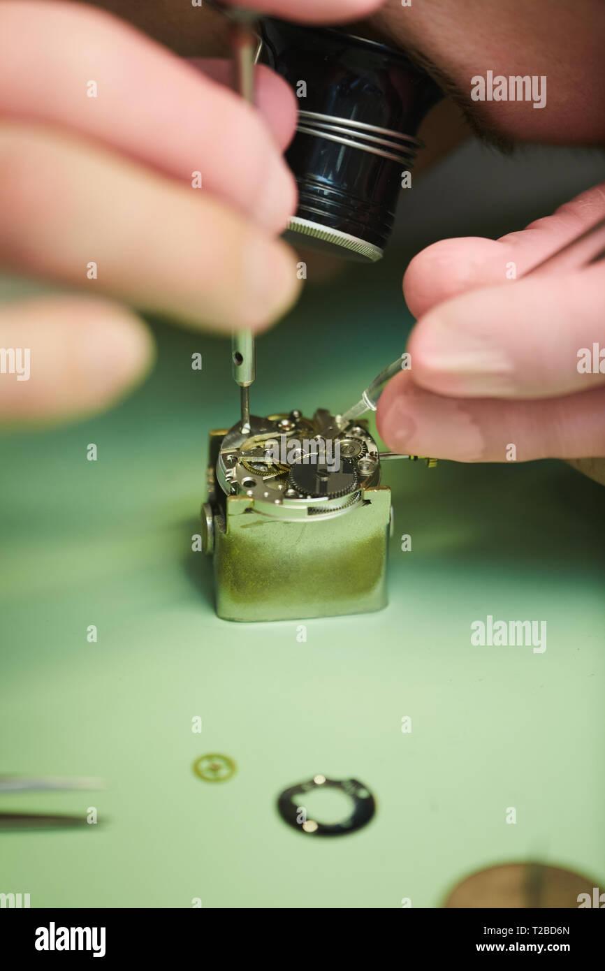 Clockmaker Repairing Watch - Stock Image