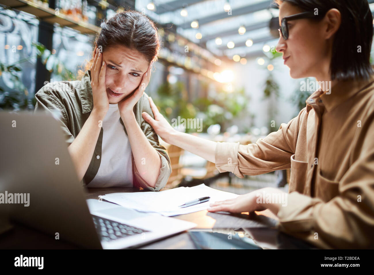 Young woman losing money after failed campaign Stock Photo