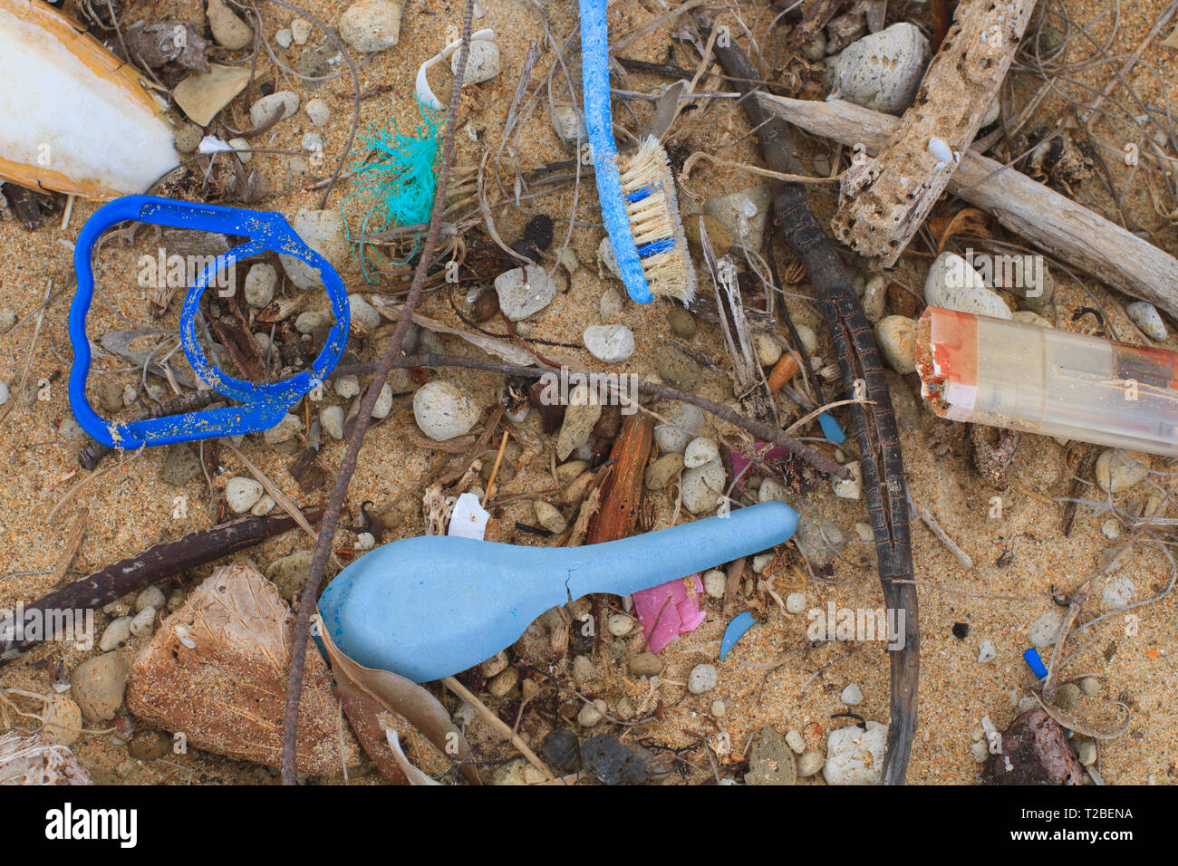 Pieces of plastic thrown from fishing vessels operating in Australian northern waters washed up on a beach on the west coast of Cape York, Australia.  - Stock Image
