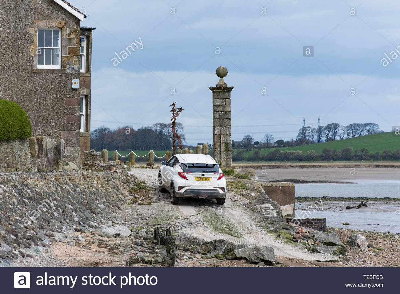 Difficult driving on the shore at Sunderland Point on the Lune Estuary near Lancaster. The village is cut off at high tides. Stock Photo