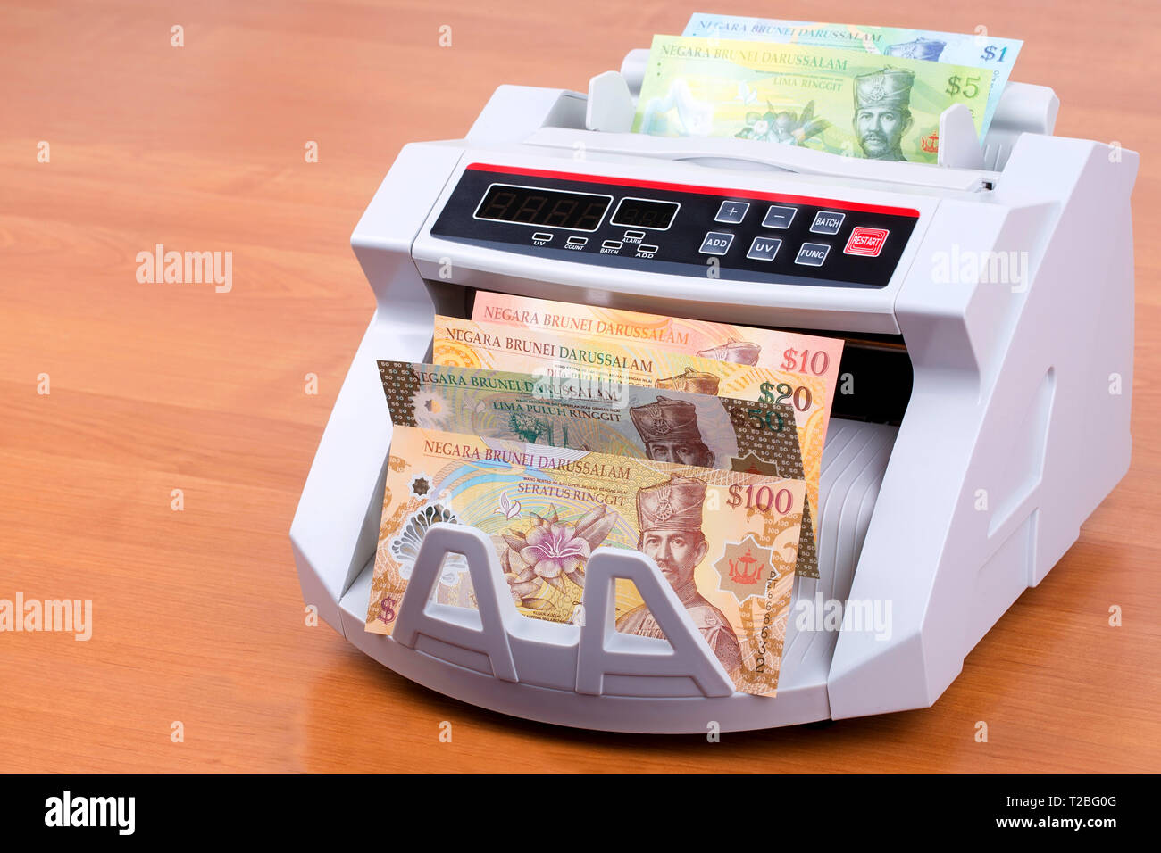 Brunei money in a counting machine - Stock Image