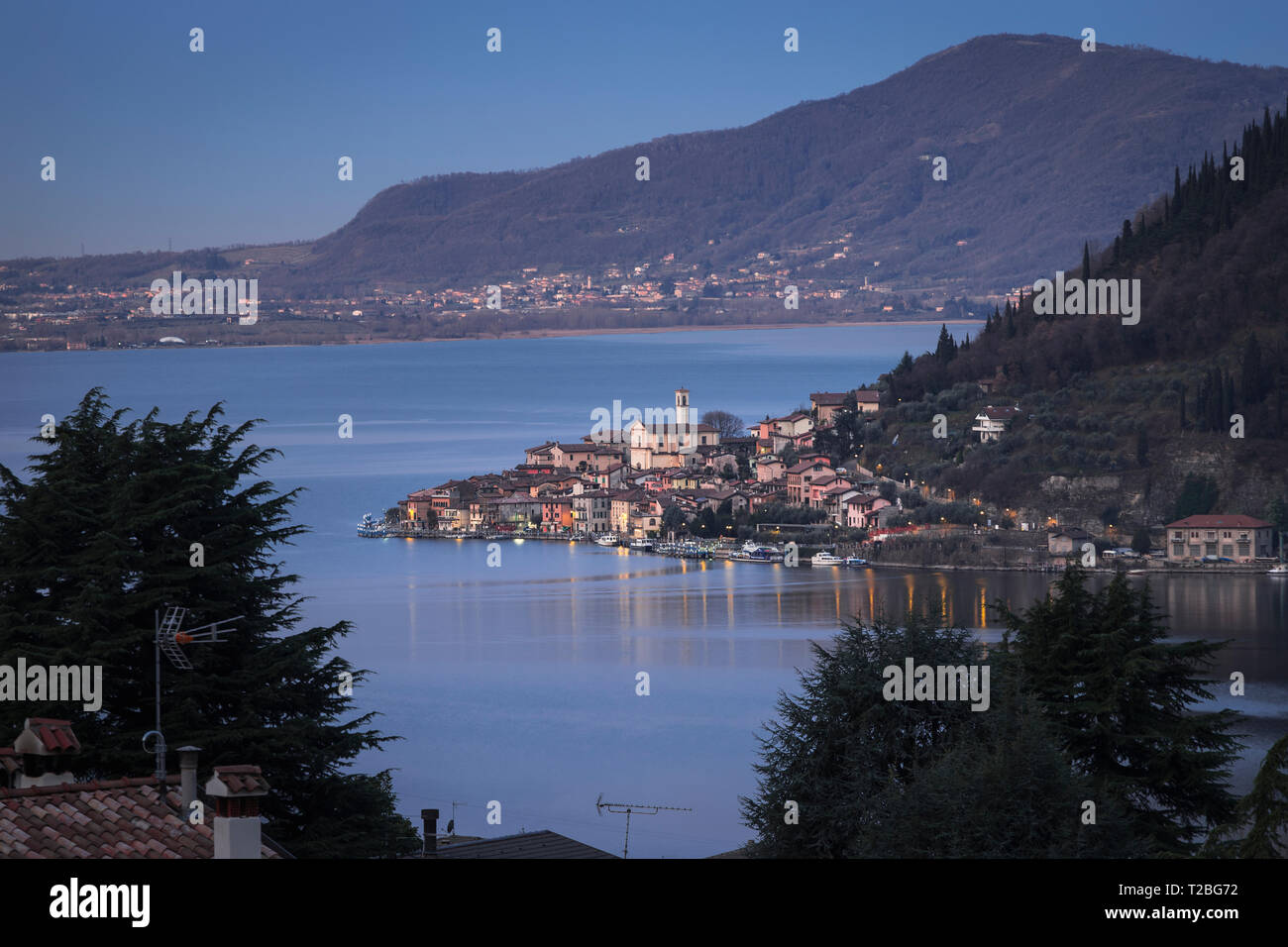 Lake Iseo with the town of Peschiera Maraglio on Monte Isola at down, Lombardy, Italy - Stock Image