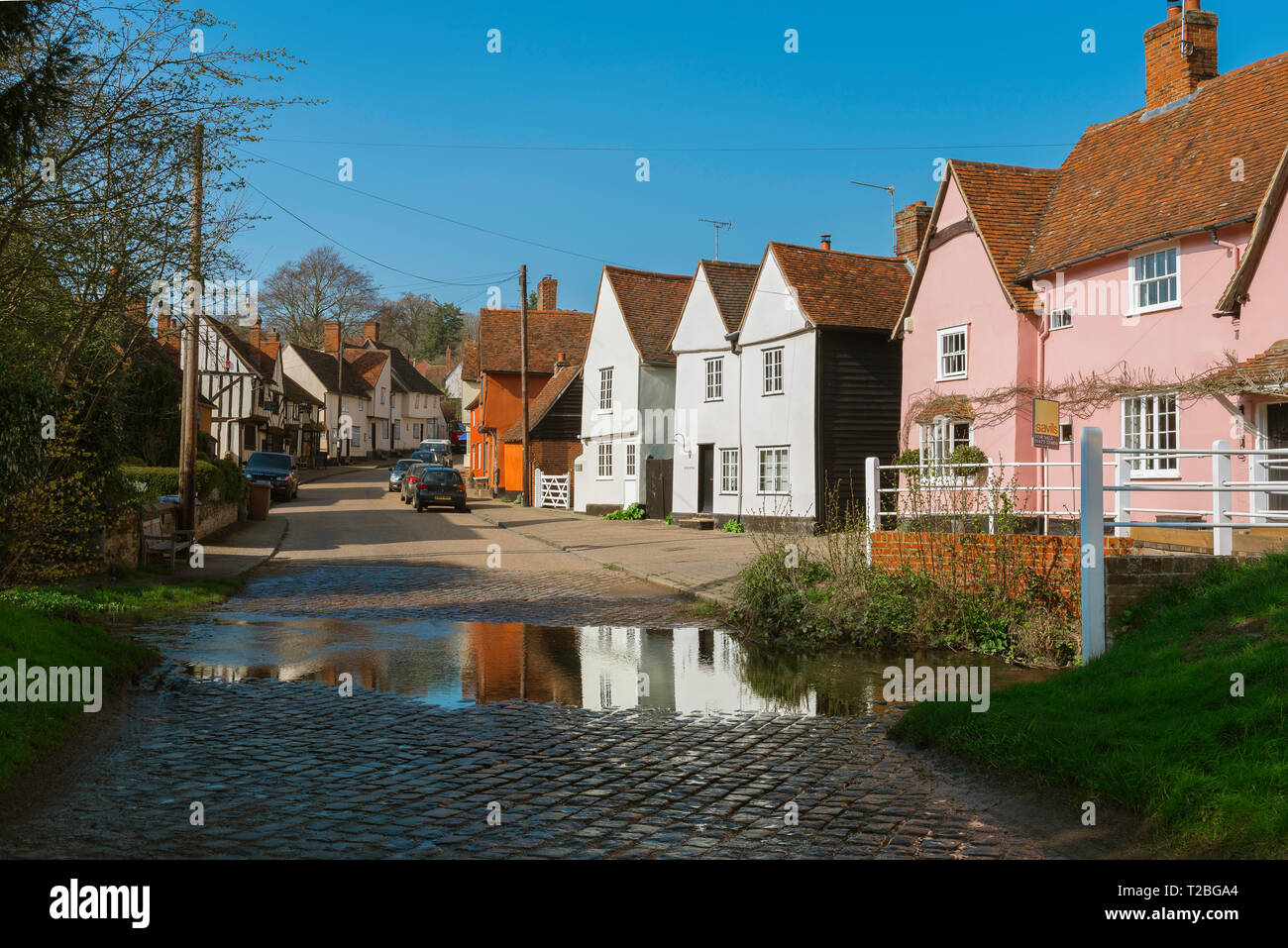 Village England, view of The Street in the centre of Kersey village, with its famous ford or 'splash' in the foreground, Suffolk, England, UK. - Stock Image