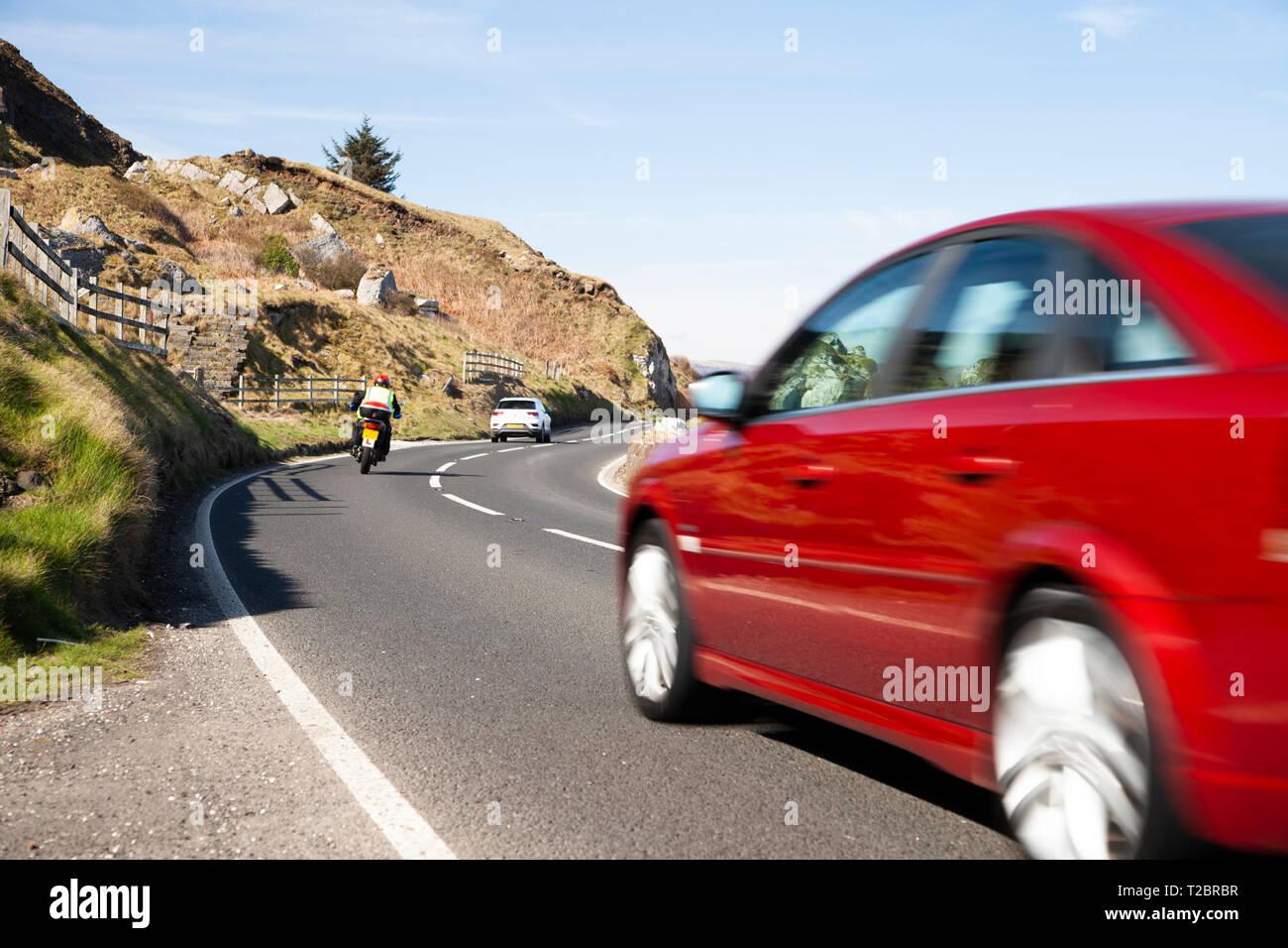 Traffic moving on the Antrim Coast Road Stock Photo