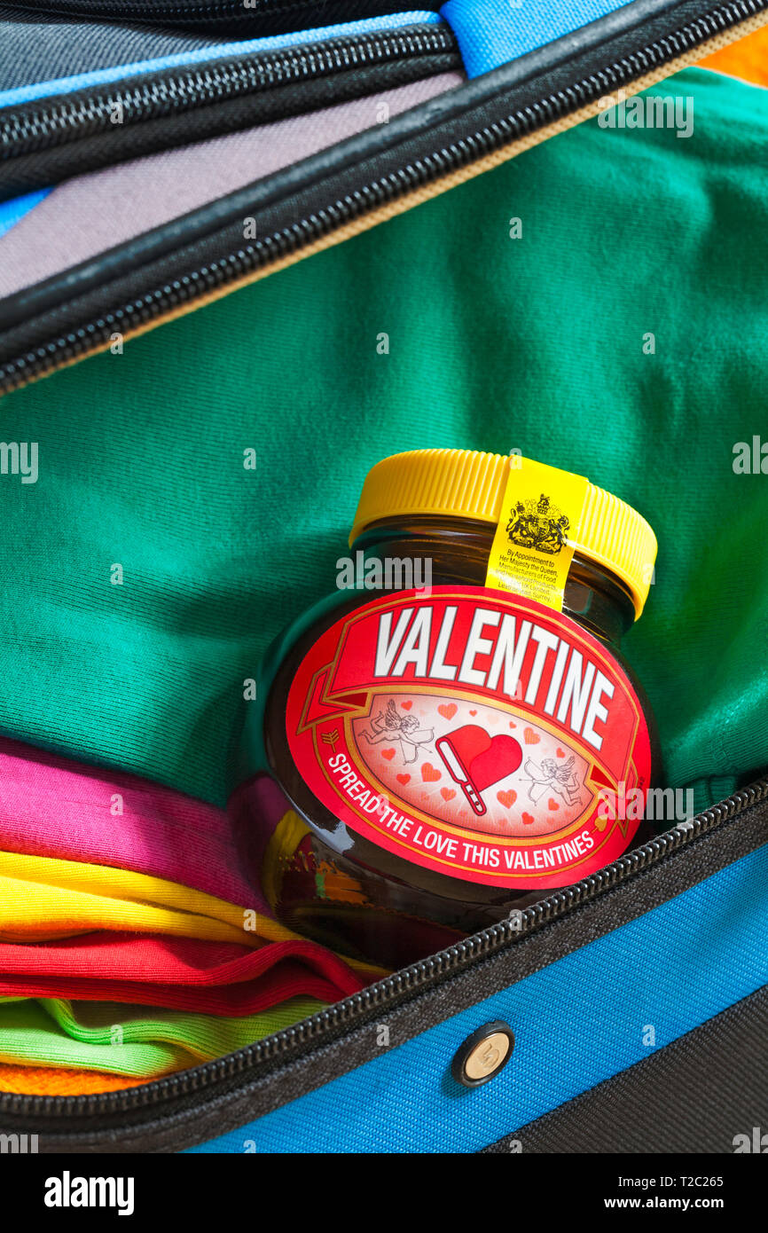 Special edition jar of Valentine Marmite by Unilever, spread the love this Valentines, packed in suitcase ready for holiday - Stock Image