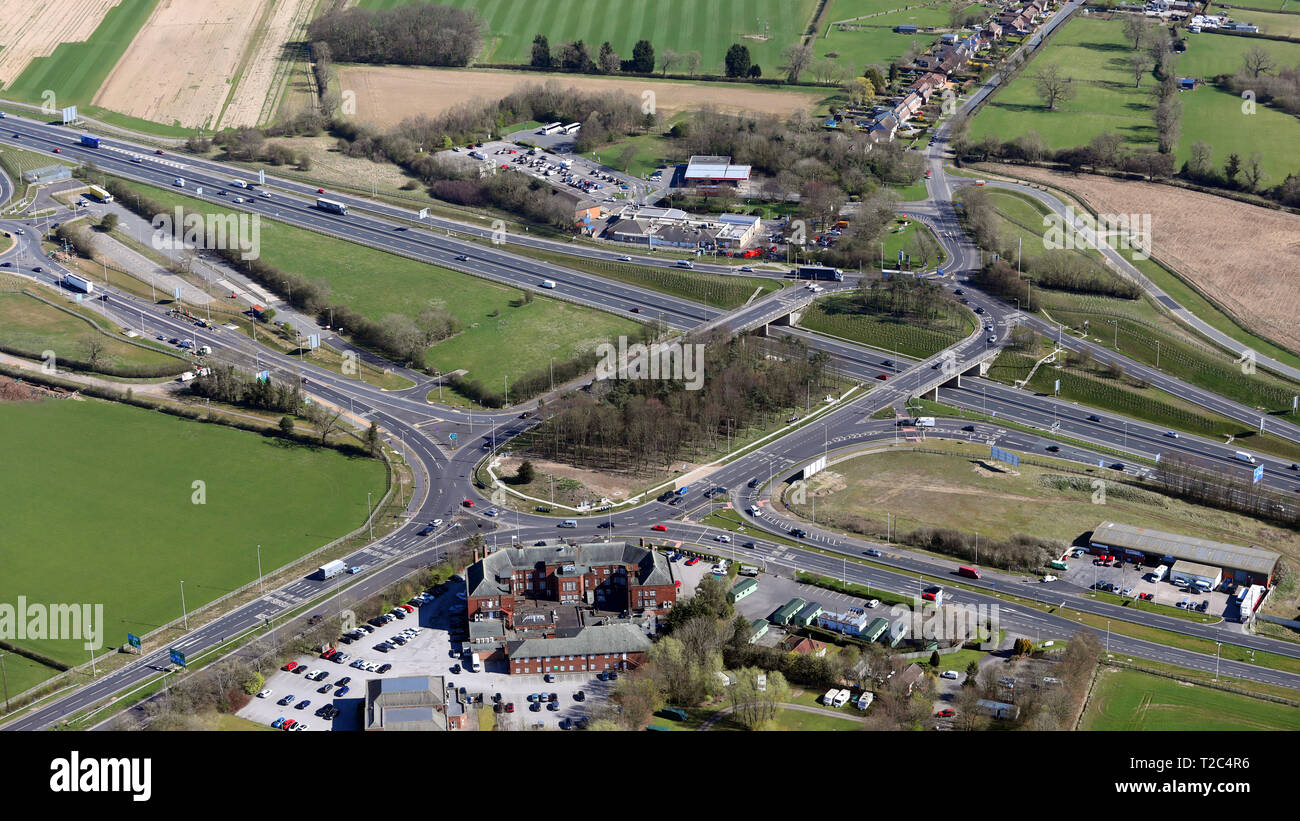 aerial view of Scotch corner junction where the A1M meets the A66 trunk road, North Yorkshire - Stock Image
