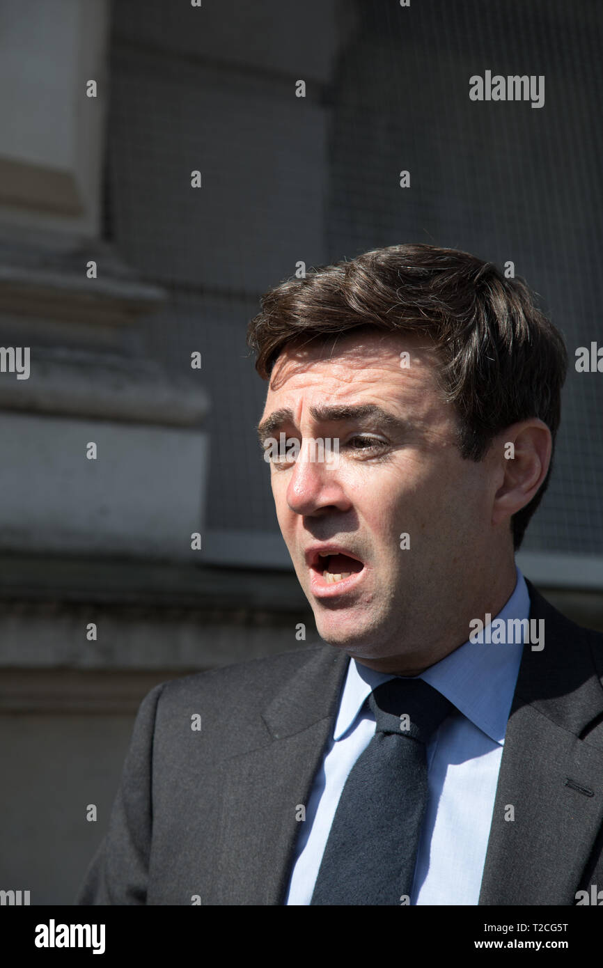 London, UK. 1st Apr, 2019. (L to R) Andy Burnham, Mayor of Greater Manchester, talks to reporters (off camera view) soon after the meeting on violent crime held by the Prime Minister in Downing Street, Westminster. Credit: Santo Basone/Alamy Live News - Stock Image