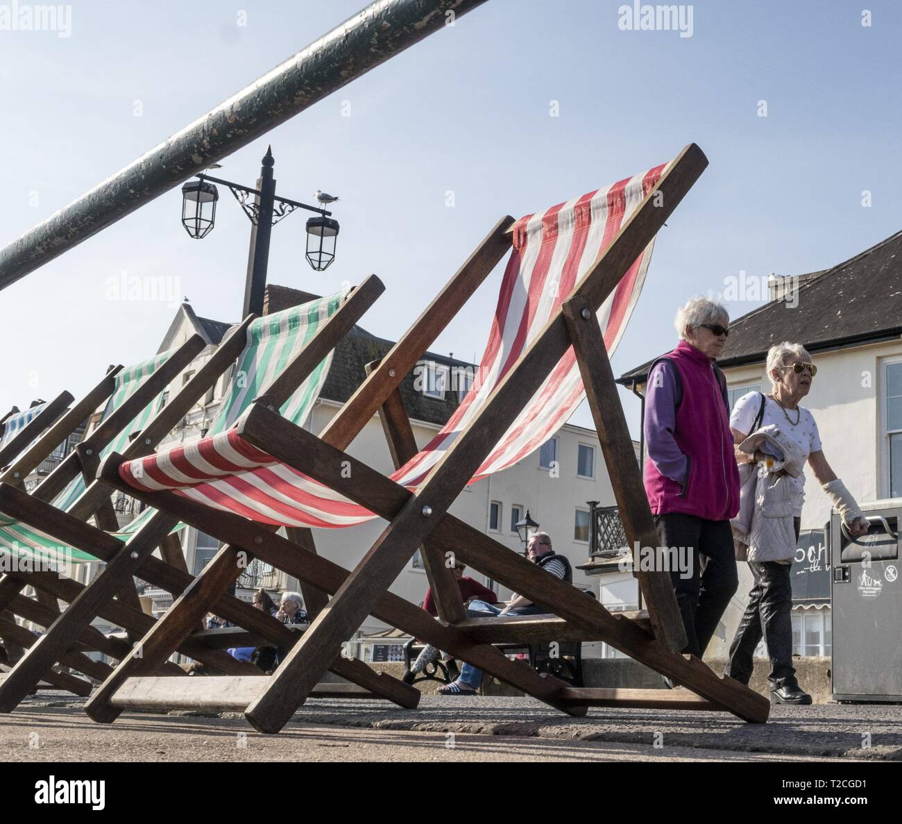 Sidmouth, 1st Apr 19 With the arrival of April, deckchairs are once more out along the seafront at Sidmouth in Devon on a glorious springtime day. Credit: Photo Central/Alamy Live News Stock Photo