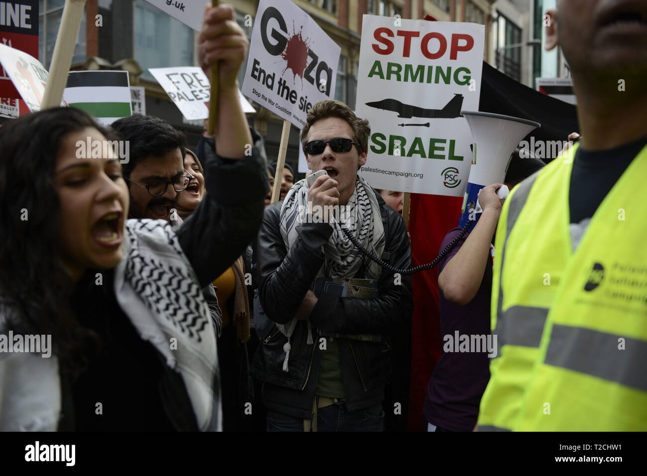 London, Greater London, UK. 30th Mar, 2019. Protester are seen chanting slogans during the Exist, Resist, Return Rally for Palestine in London.People gather outside the Israeli embassy in London to demonstrate against the Israeli government, and to demand respect for Palestinians' fundamental rights to exist, resist and return. Palestinians are calling for global protests to support their right to come back to their villages. Rally was organized by Palestine Solidarity Campaign, Stop the War Coalition, Palestinian Forum in Britain, Friends of Al- Aqsa, and Muslim Association o - Stock Image