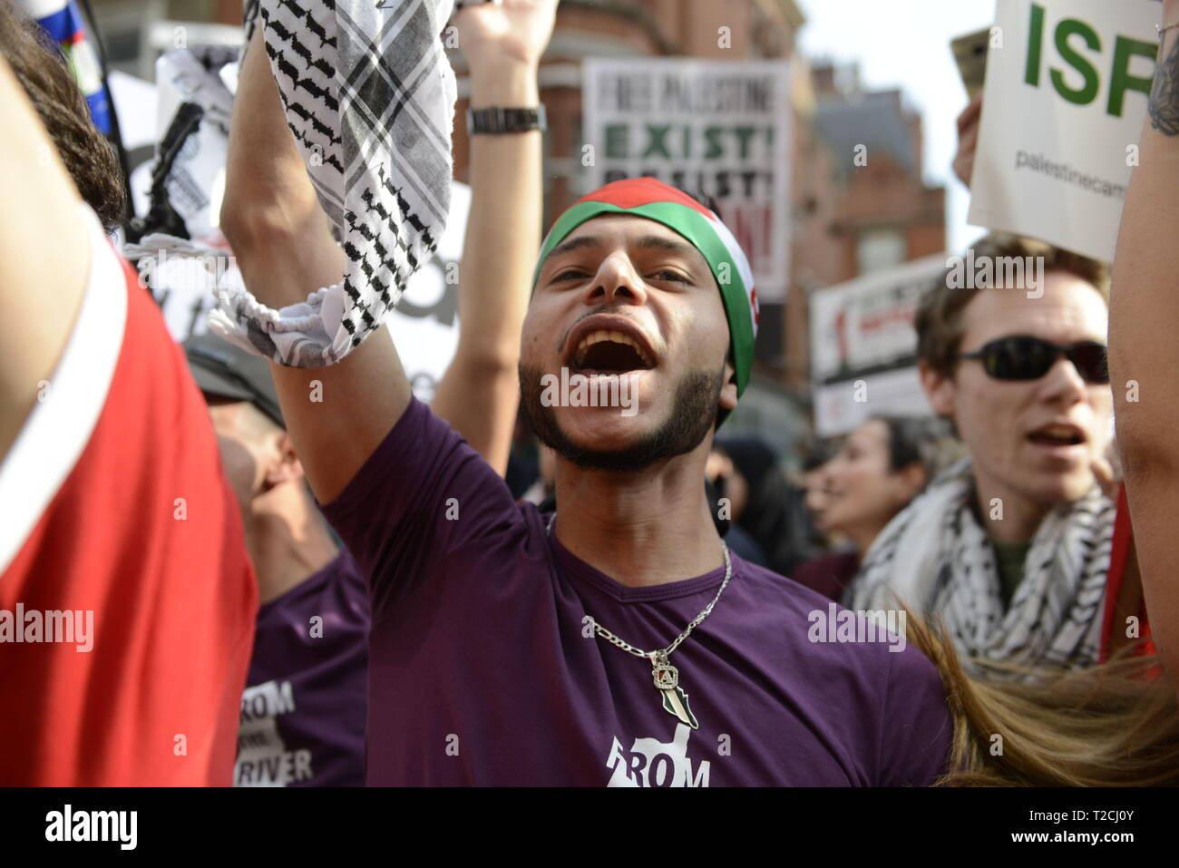 London, Greater London, UK. 30th Mar, 2019. A protester is seen chanting slogans during the Exist, Resist, Return Rally for Palestine in London.People gather outside the Israeli embassy in London to demonstrate against the Israeli government, and to demand respect for Palestinians' fundamental rights to exist, resist and return. Palestinians are calling for global protests to support their right to come back to their villages. Rally was organized by Palestine Solidarity Campaign, Stop the War Coalition, Palestinian Forum in Britain, Friends of Al- Aqsa, and Muslim Association - Stock Image