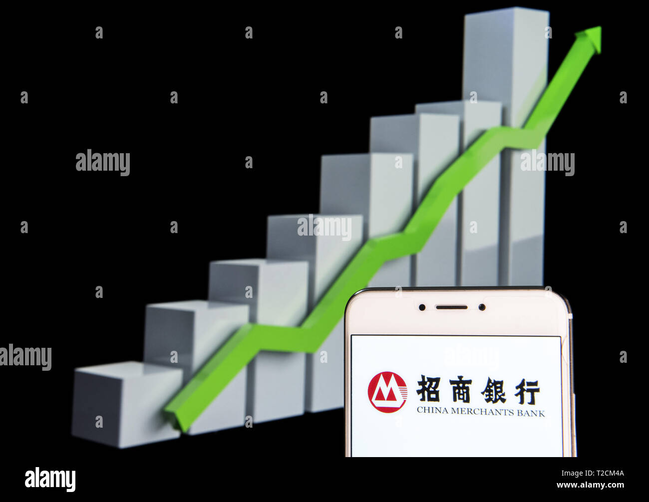 Hong Kong. 11th Feb, 2019. In this photo illustration a Chinese state-owned banking and financial corporation China Merchants Bank logo is seen on an android mobile device with an ascent growth chart in the background. Credit: Budrul Chukrut/SOPA Images/ZUMA Wire/Alamy Live News - Stock Image
