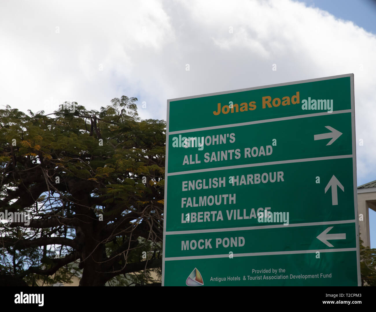 Green road sign in Antigua, The Caribbean - Stock Image