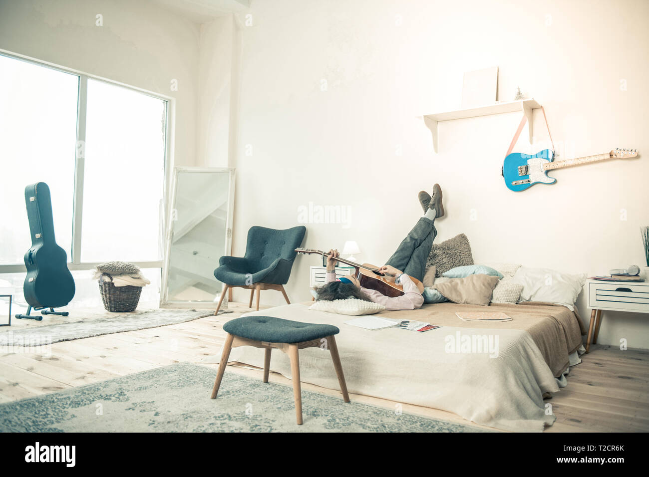 Good Looking Artist Lying On Bed In Bright Stylish Bedroom Stock Photo Alamy