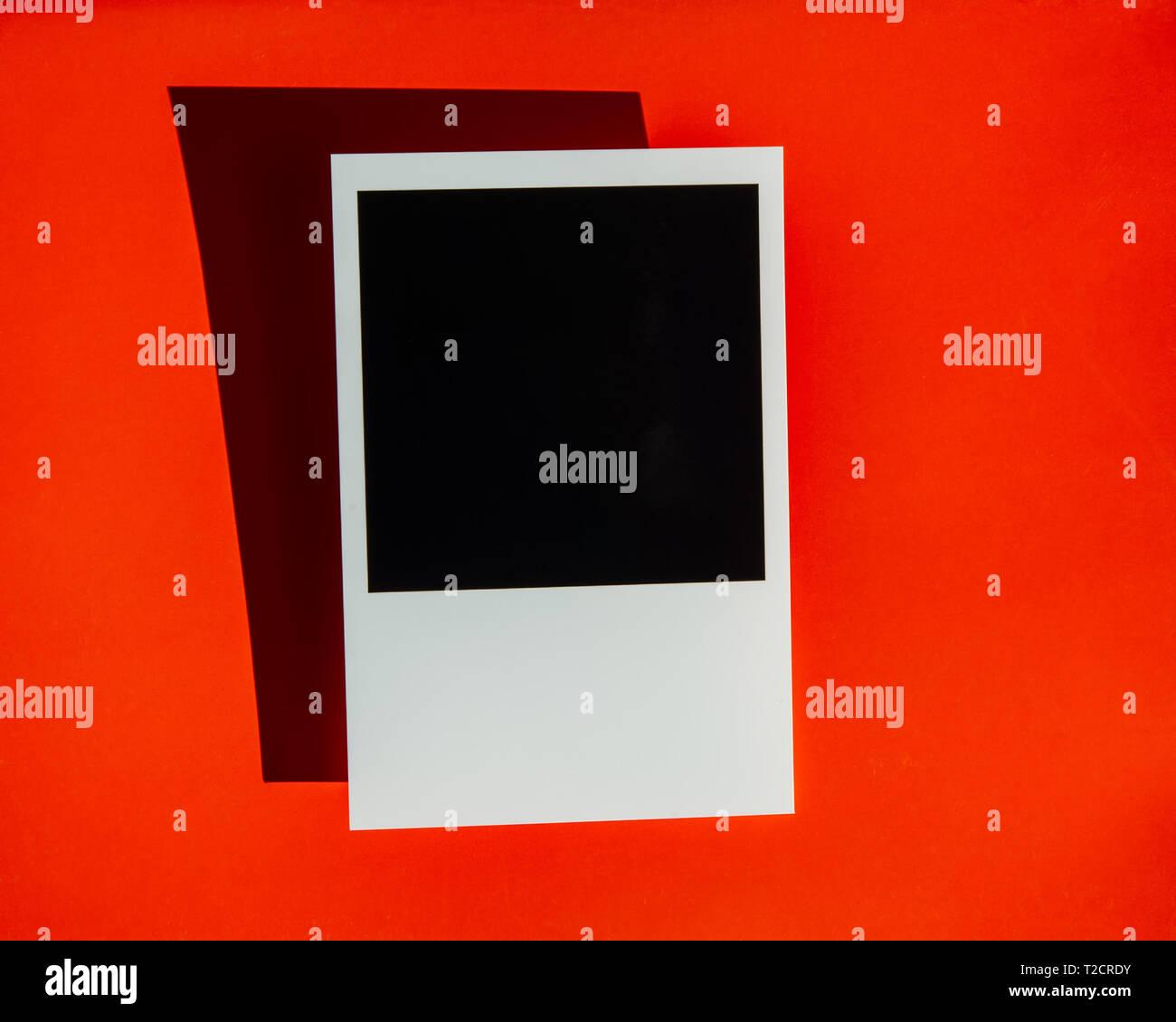 photo with black square on orange background - Stock Image