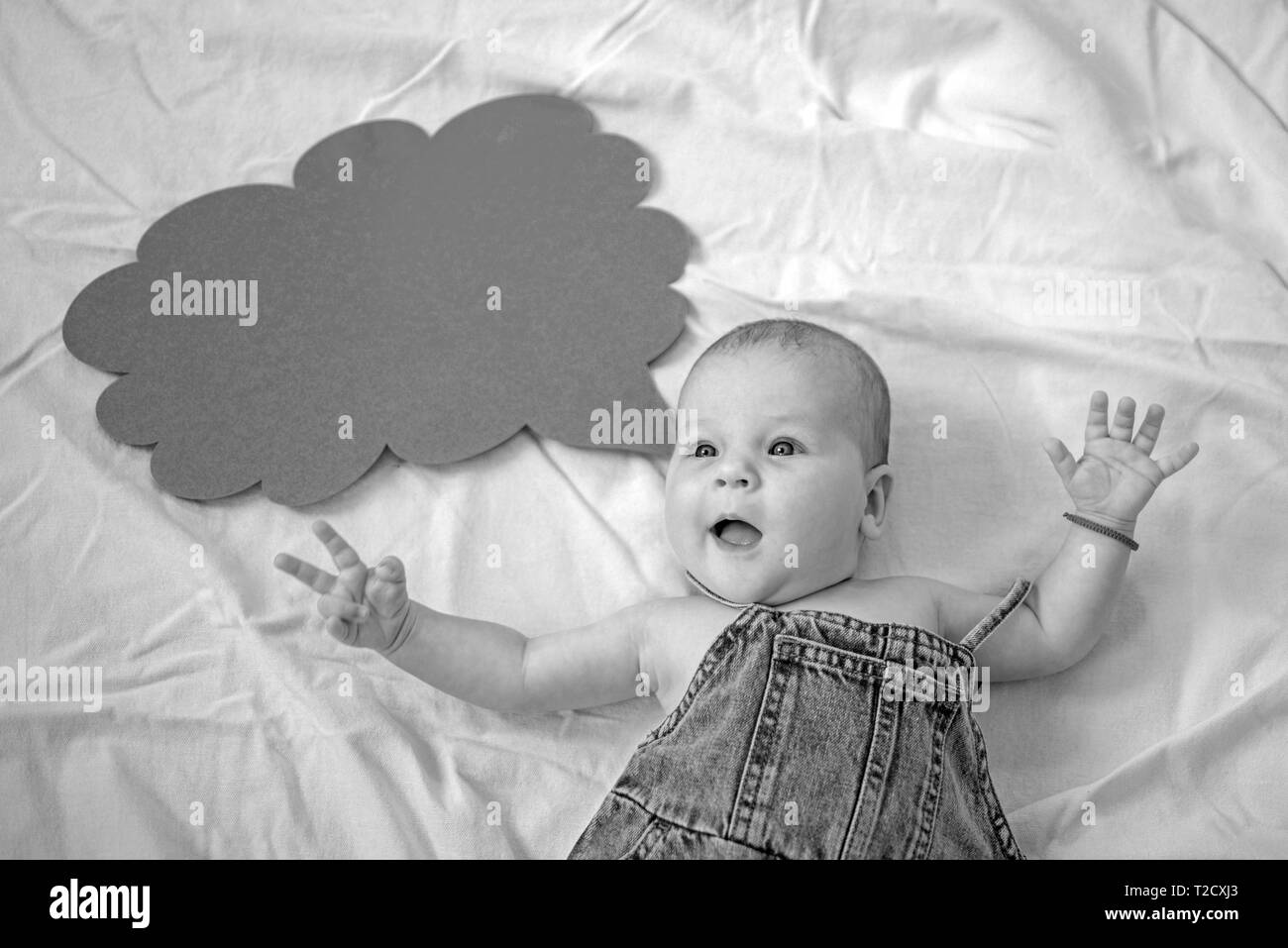That was unexpected. Portrait of happy little child. Sweet little baby. New life and birth. Family. Child care. Childrens day. Small girl. I can speak - Stock Image