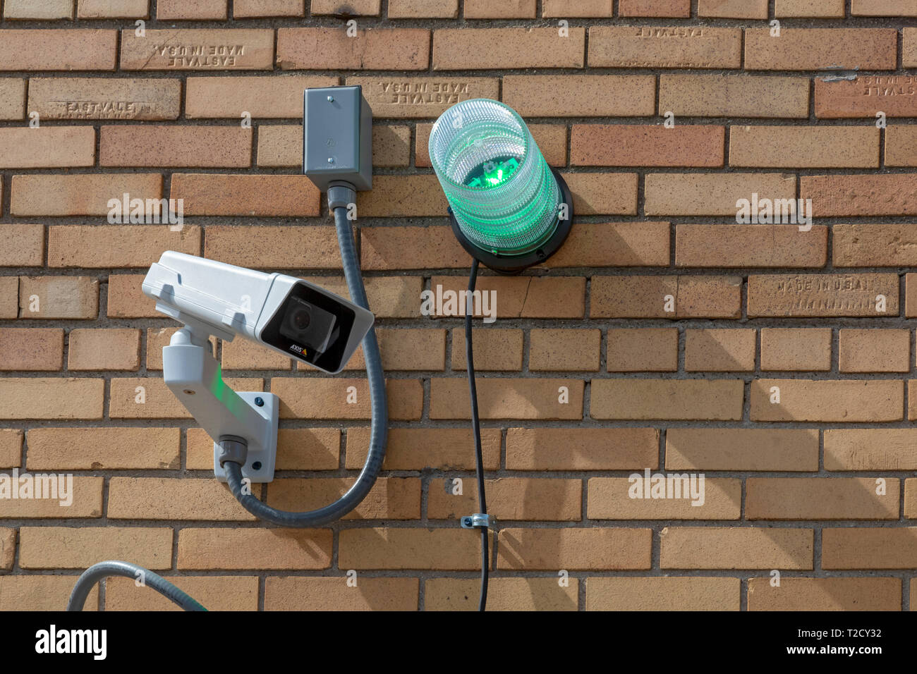 Detroit, Michigan - A green strobe light and surveillance camera outside a business participating in Detroit's Green Light anti-crime program. The pol - Stock Image