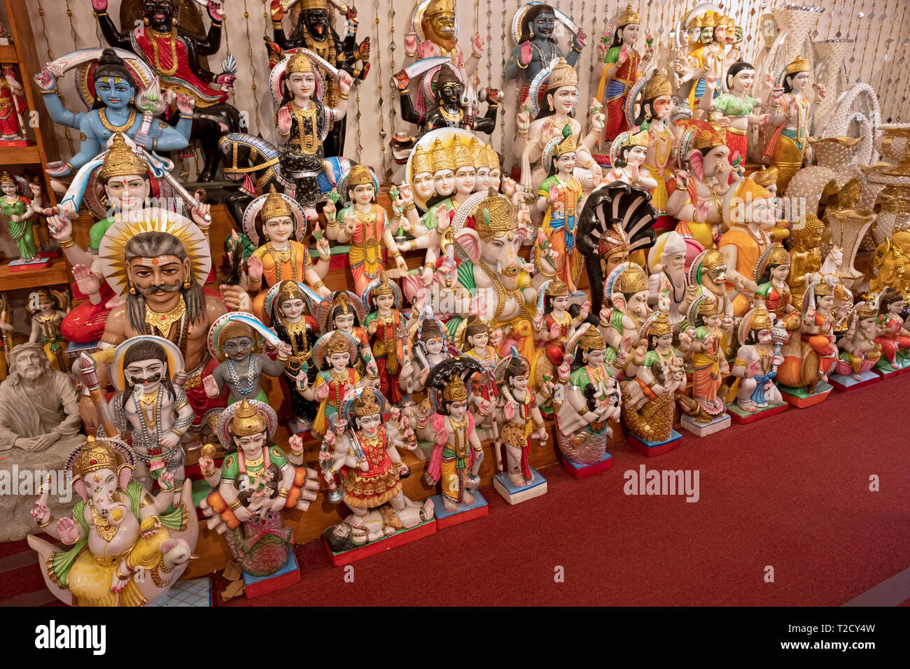 A large variety of statues of Hindu deities for sale at Maha Shakti, a store that sells religious items and ethnic clothing in Queens, New York. - Stock Image