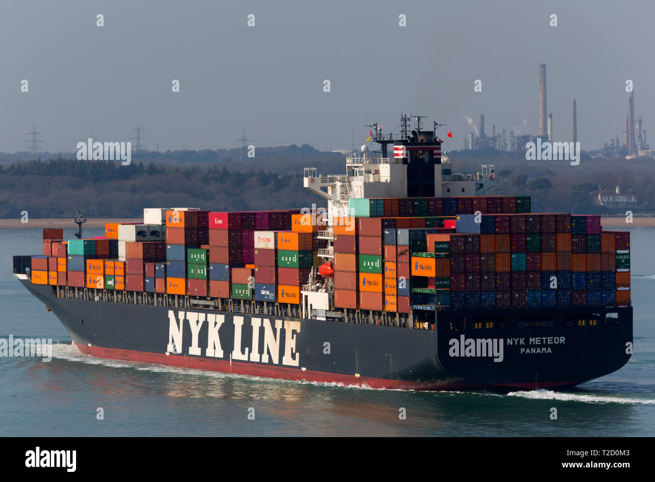 Container,Ship, NYK,company, Meteor, registered,Panama, Southampton,Container,Terminal,Fawley,Oil,refinery,The Solent,Cowes,Isle of Wight,UK, - Stock Image