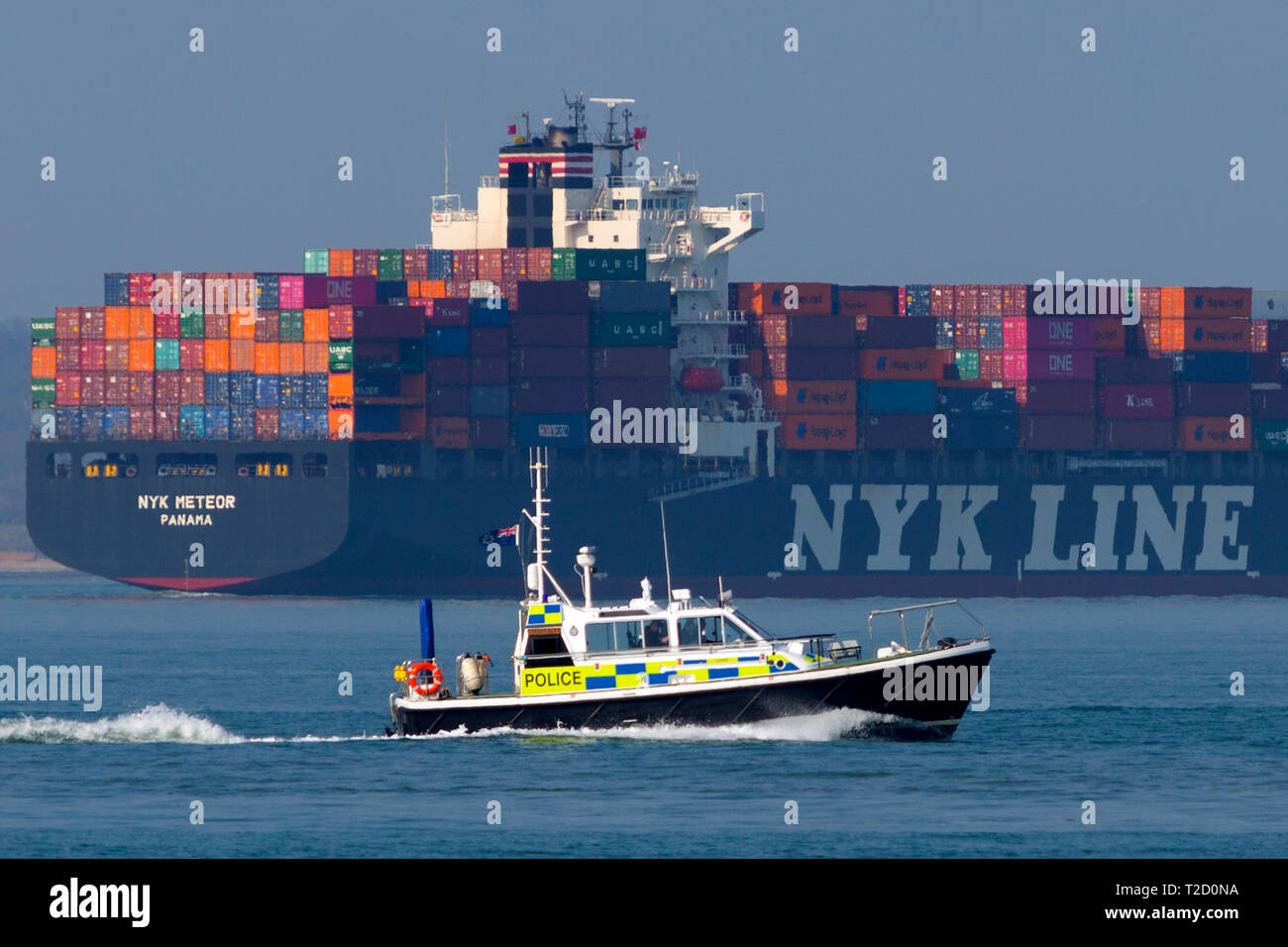MOD,Police,Launch,Loyalty,Container,Ship, NYK,company, Meteor, registered,Panama, Southampton,Container,Terminal,The Solent,Cowes,Isle of Wight,busy - Stock Image