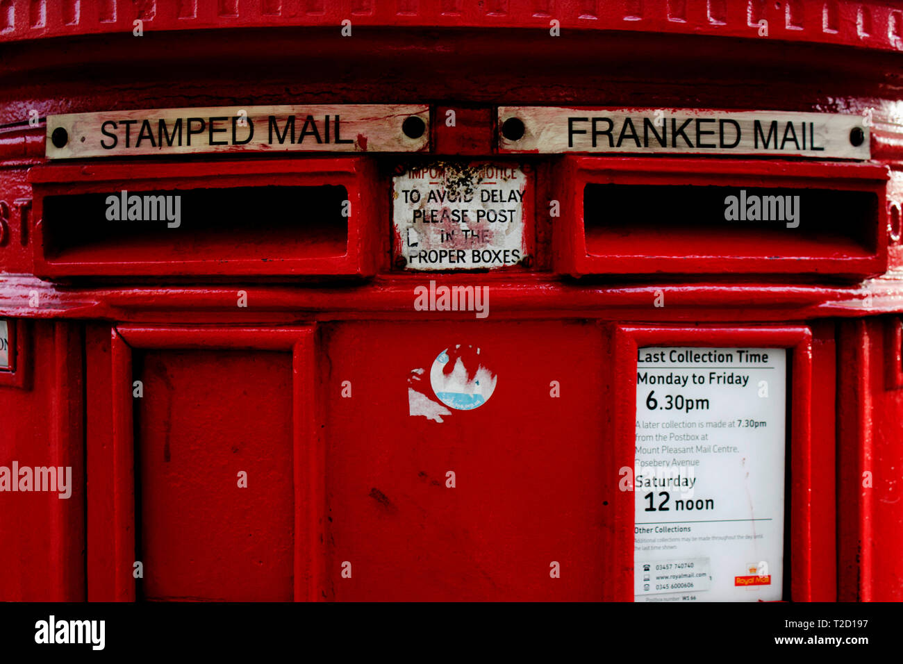 red post box for stamped mail and franked mail in London, Great Britain - Stock Image