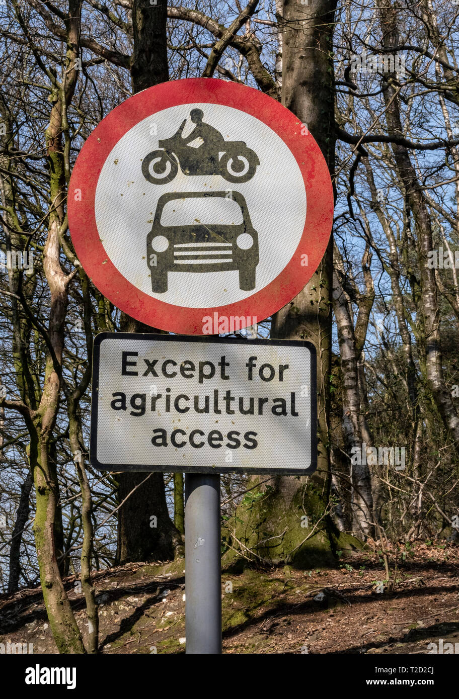 Sign post, no vehicles, vehicular access except agricultural access. Stock Photo