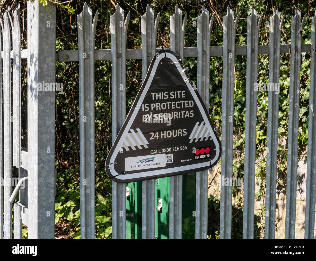 Securitas sign on a steel fence, 24 hour security, notice, Stock Photo