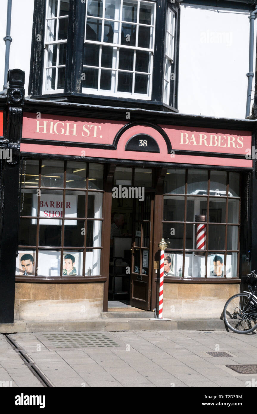 An English traditional barber's shop with its red and white coloured pole in the High Street, Oxford, Britain - Stock Image