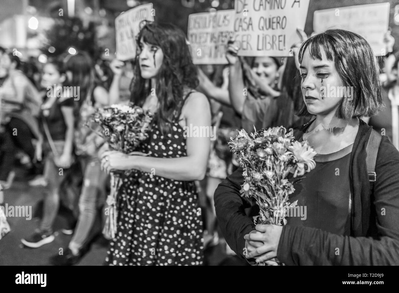 International Women's Day 8 March Feminist girls urban tribes with death costume clothes in women's day protest at Santiago, Chile, city centre street - Stock Image