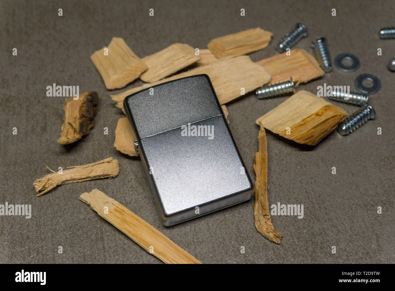 Zippo with wooden chips - Stock Image