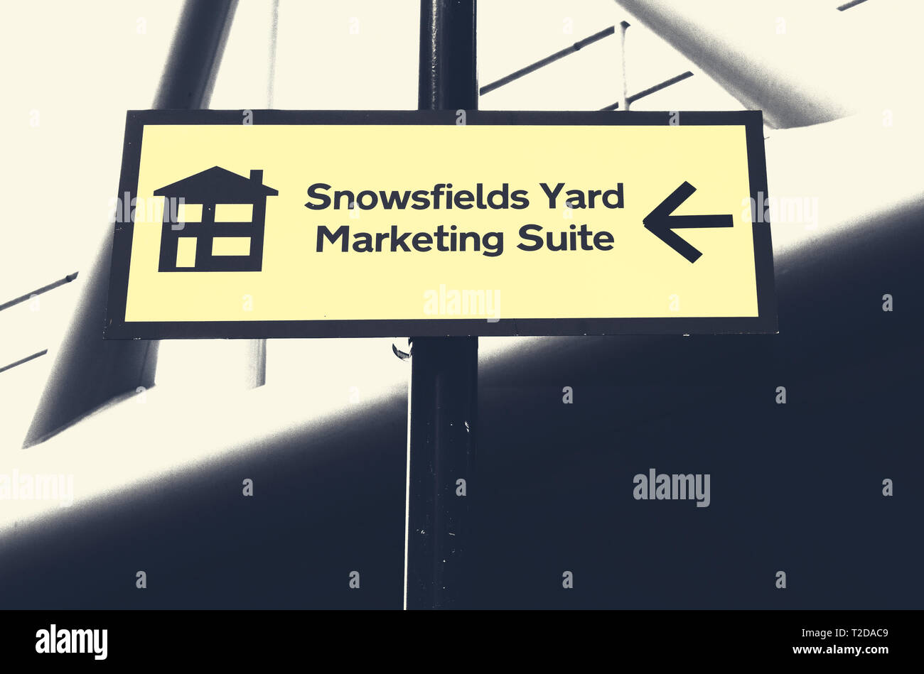 direction sign to the luxury urban quarter Snowsfields Yards Marketing Suite in London - Stock Image