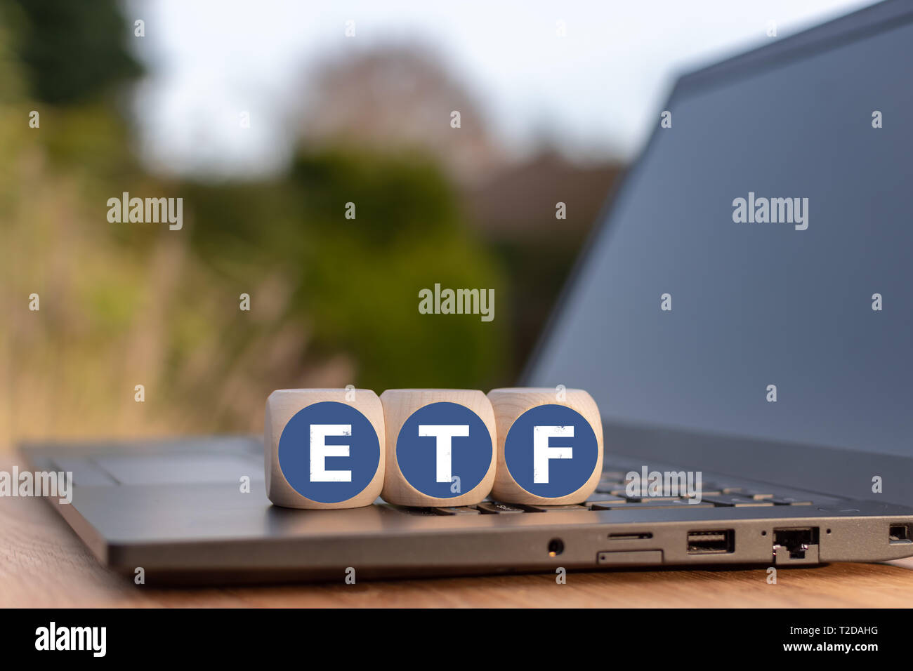 "Cubes placed on a Notebook with the letters ""ETF"" which stands for ""Exchange traded funds"". Stock Photo"