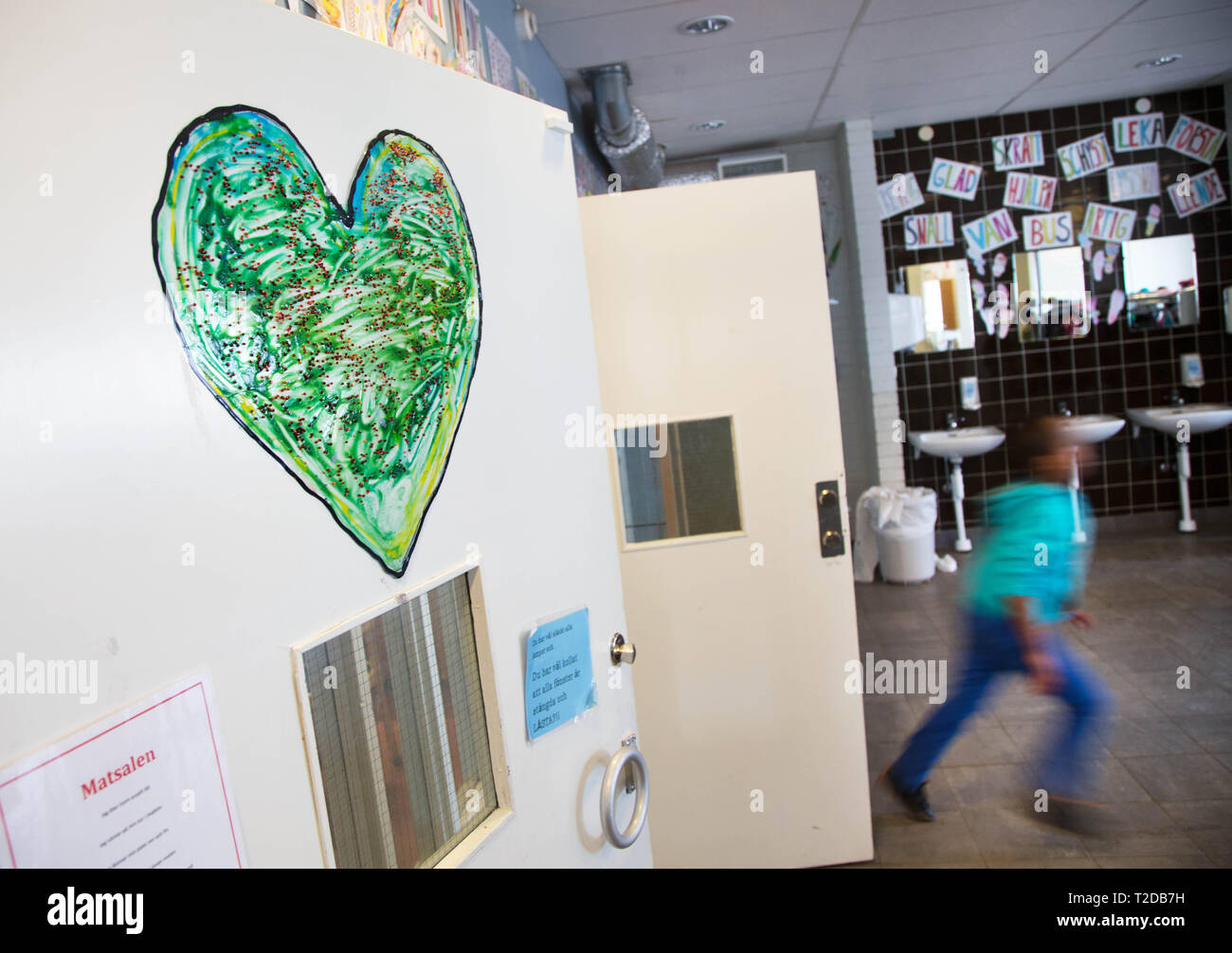 A painted heart in a school. - Stock Image