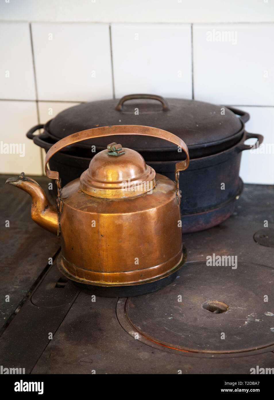 Coffee pot on an old wood stove in a kitchen. - Stock Image