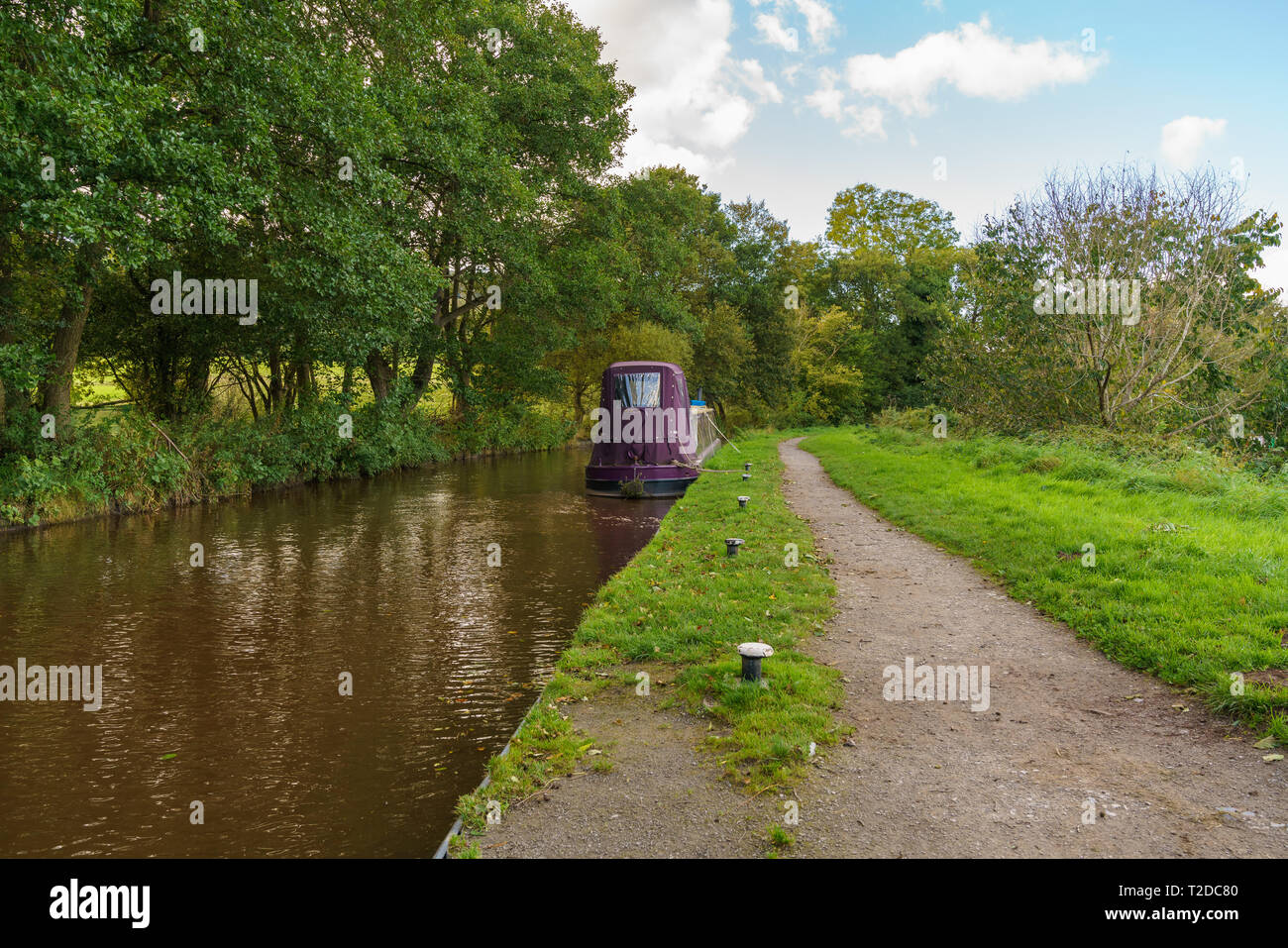 The Monmouthshire & Brecon Canal with a narrowboat, seen in Talybont on Usk, Powys, Wales, UK - Stock Image
