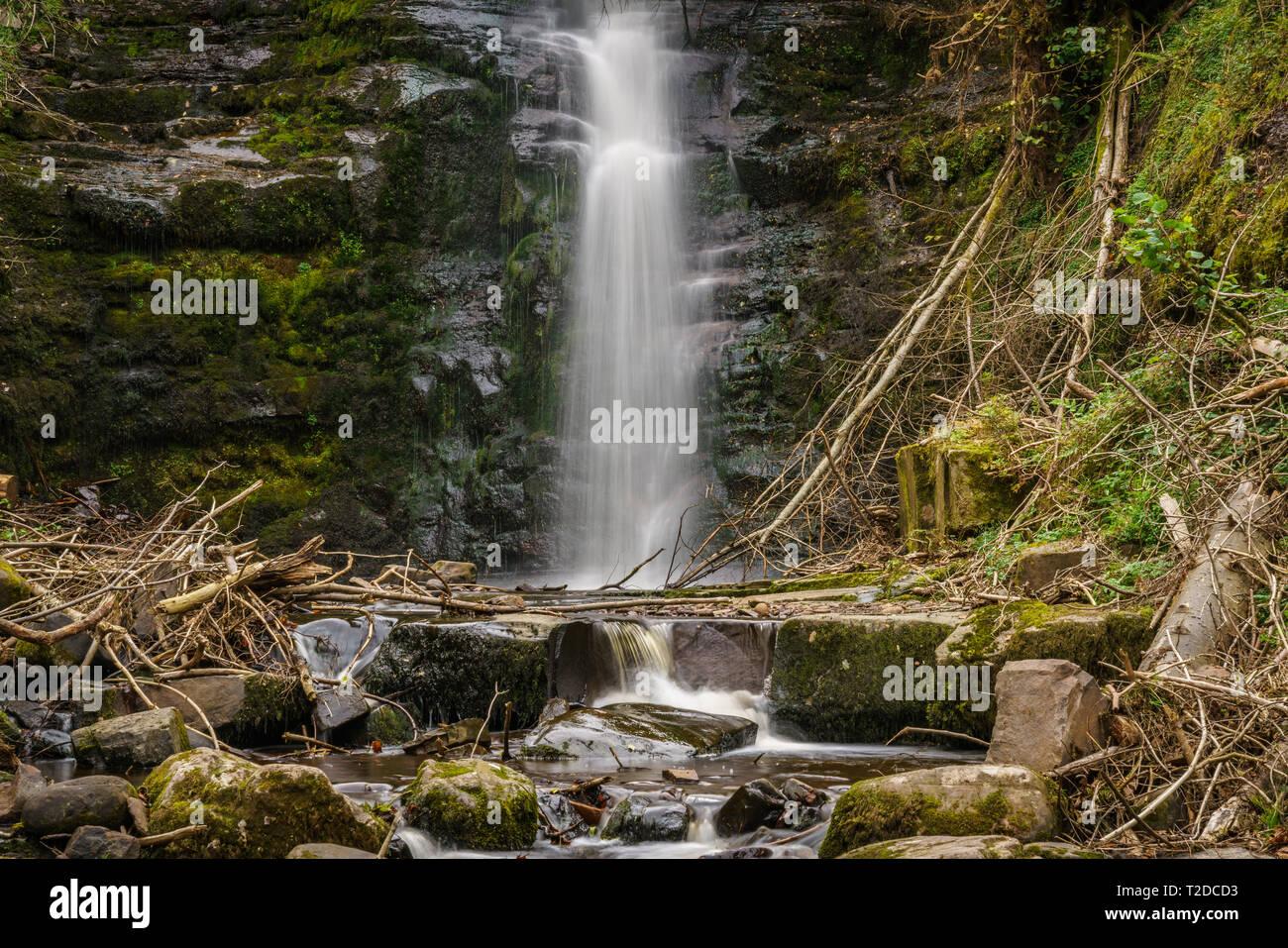 A waterfall in Blaen-y-glyn near Torpantau, Powys, Wales, UK - Stock Image