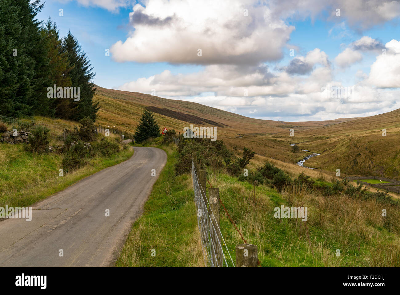 Rural road on a cloud day, near Ystradfellte in Powys, Wales, UK - Stock Image
