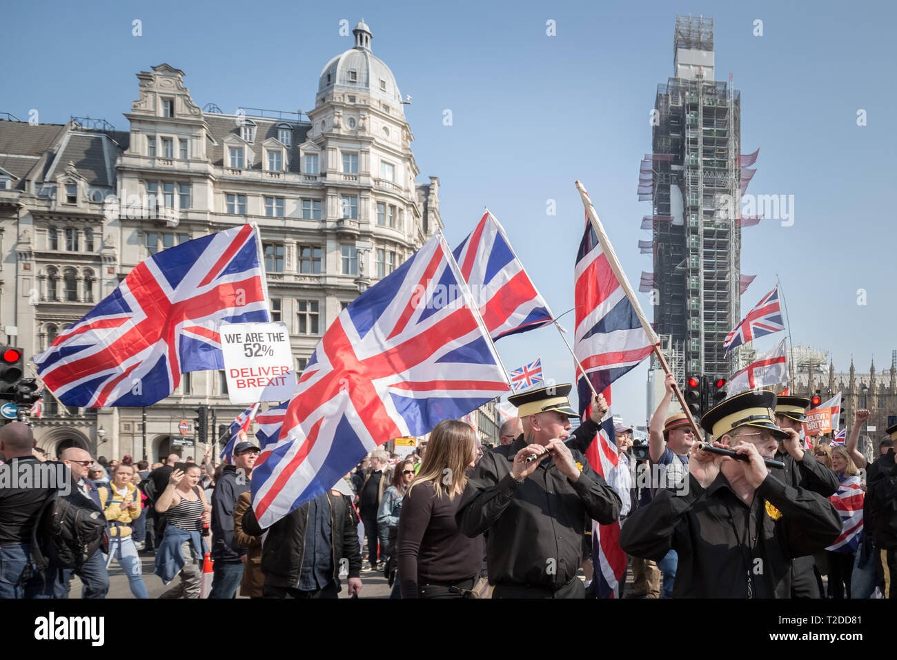 Scottish Loyalist flute band joins pro-Brexit supporters for 'Brexit Day' protest in Westminster demanding Britain leaves the EU without delay. - Stock Image