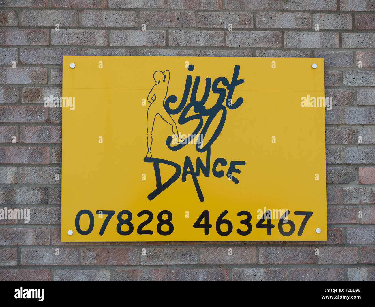 Sign on side of building indicating location of dance school in Westbury, Wiltshire, UK. - Stock Image