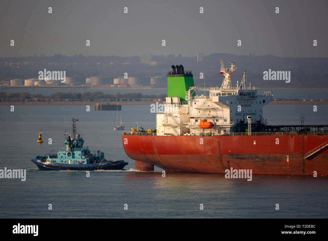 Oil,Tanker,Pacific,Jewels,Voith tractor tug,services,ABP,Southampton,Water,port,Fawley,Oil,Refinery,The Solent,Cowes,Isle of Wight,UK, - Stock Image