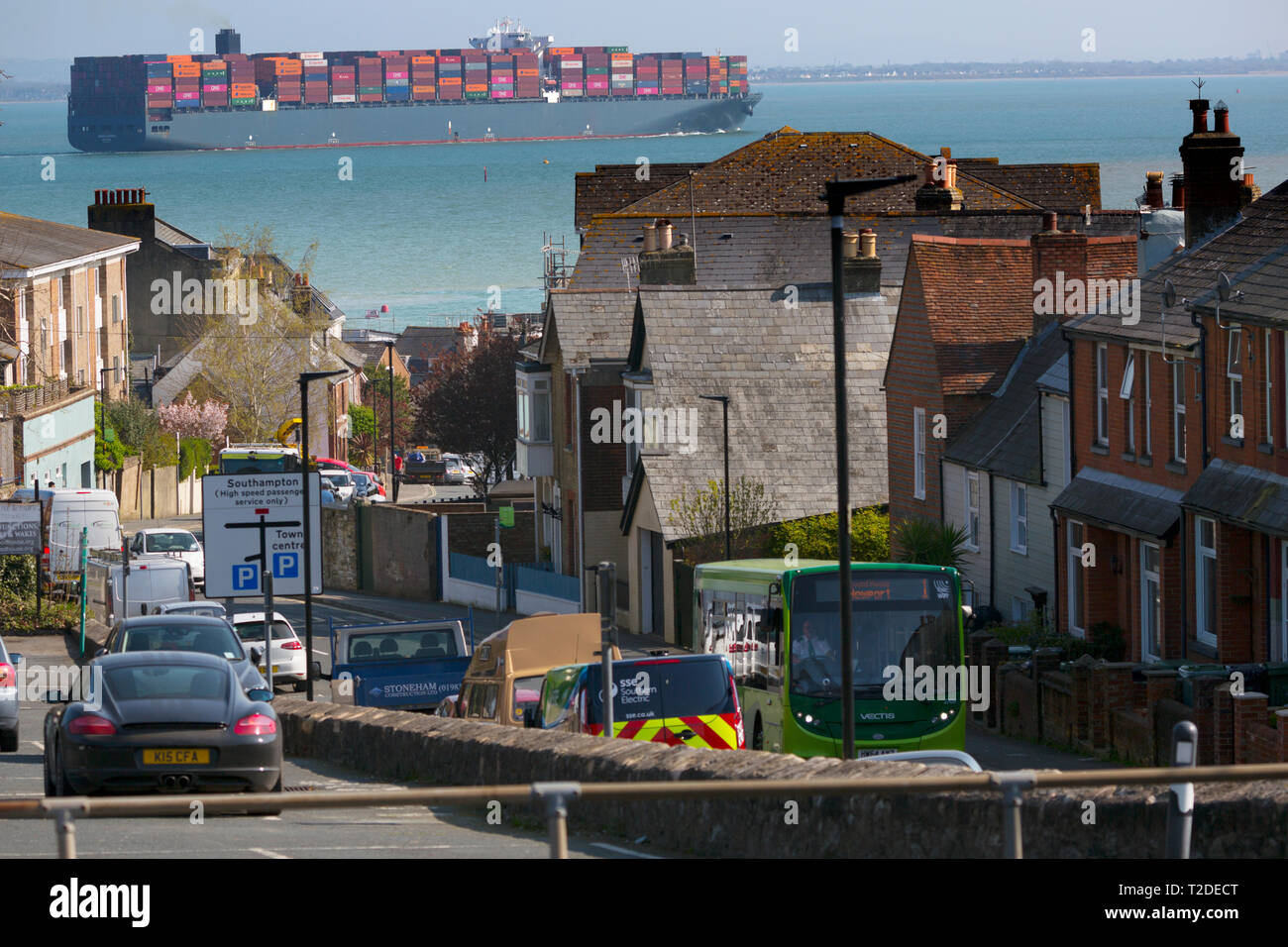 Container,Ship,Madrid,Express,Southampton,Port,Harbour,Escourt,Launch,services,Master,departure,water,The Solent,Cowes,Isle of Wight,UK, - Stock Image