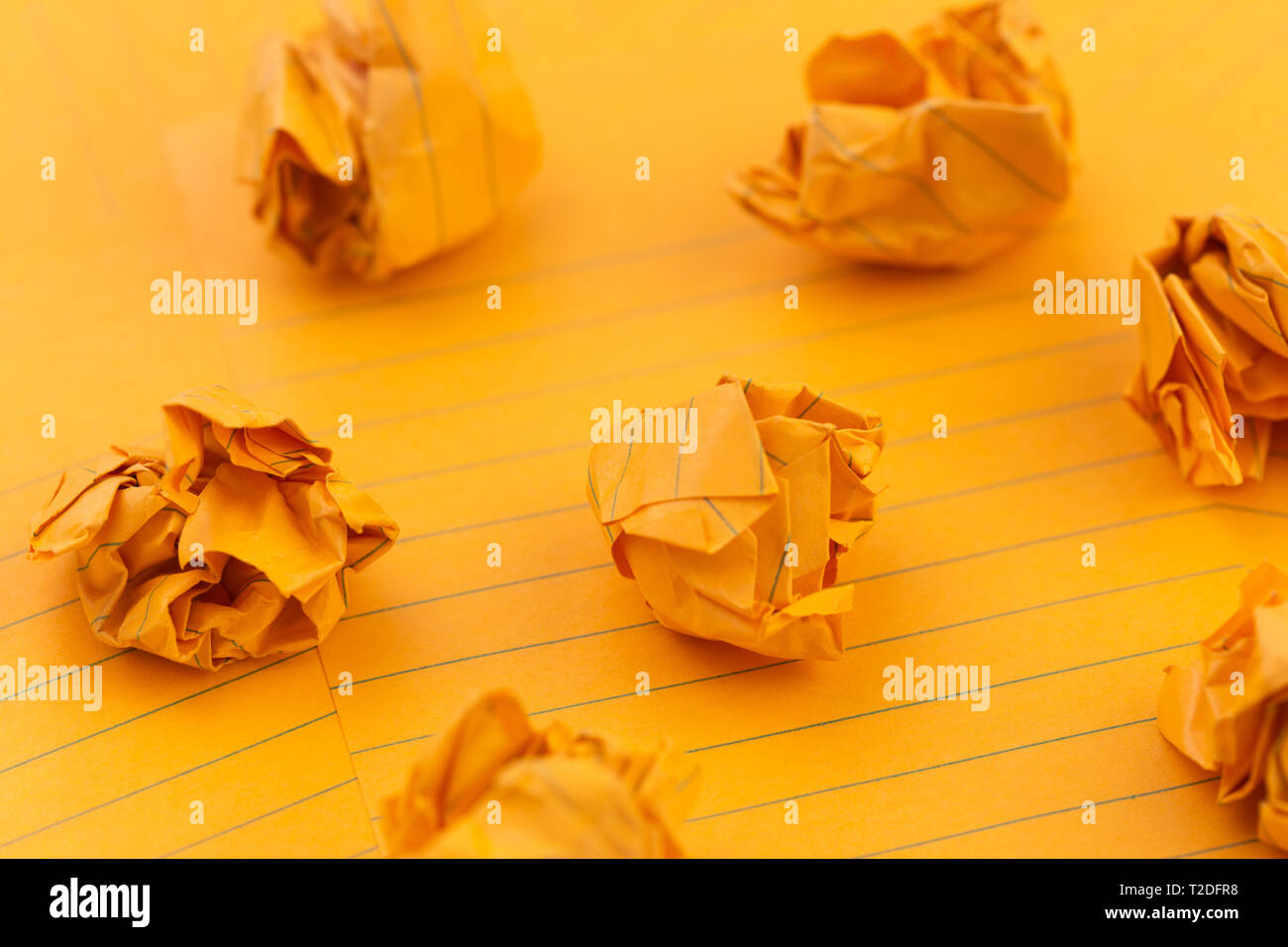 Concept Orange crumpled sheets of paper, empty space for your text - Stock Image