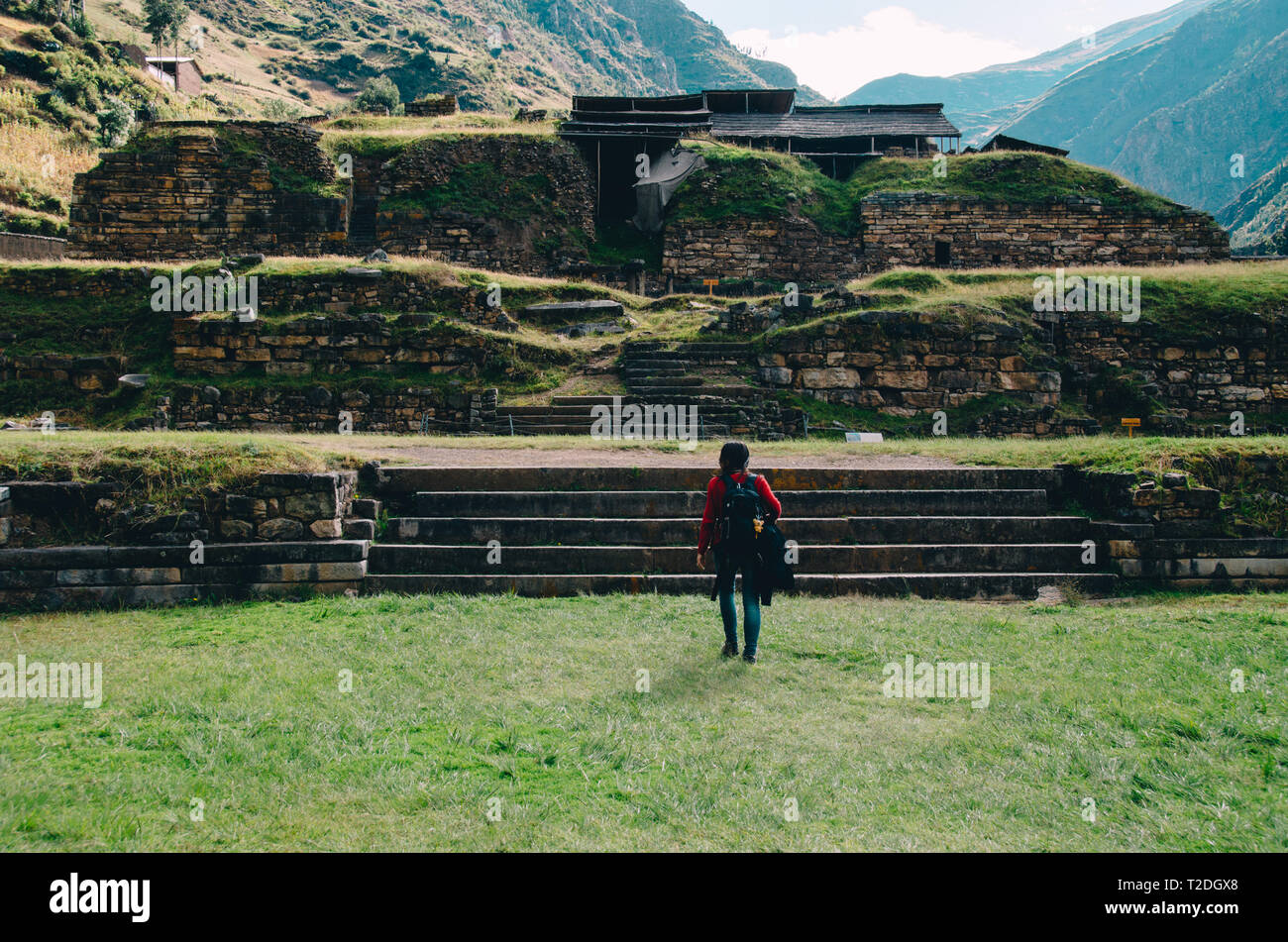 Woman visiting Chavín de Huántar, an archaeological and cultural site in the Andean highlands of Peru - Stock Image