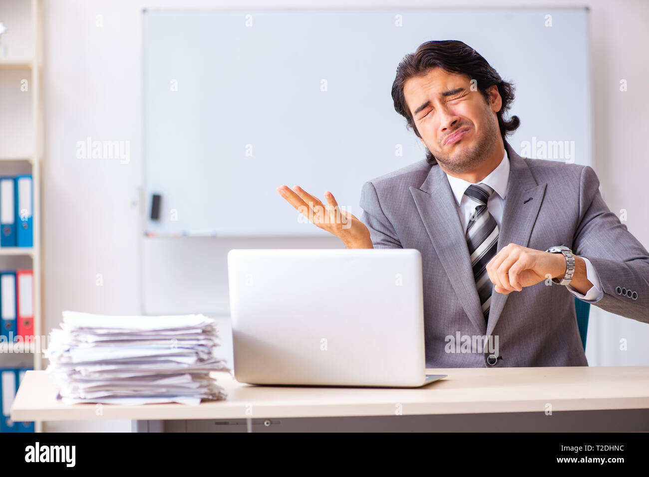 Young handsome businessman employee in the office - Stock Image