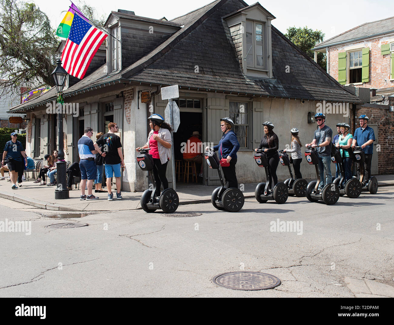 A Segway tour happening in front of Lafitte's Blacksmith Shop Bar, New Orleans, Louisiana. - Stock Image