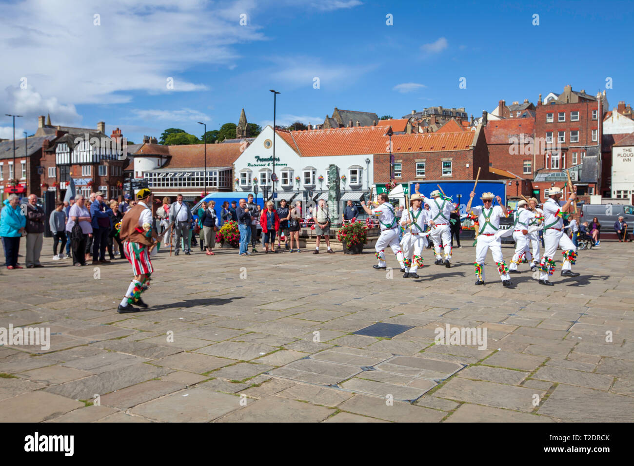 celebrations and dancing on the streets at Whitby Folk week 2018, North Yorkshire coast, England - Stock Image