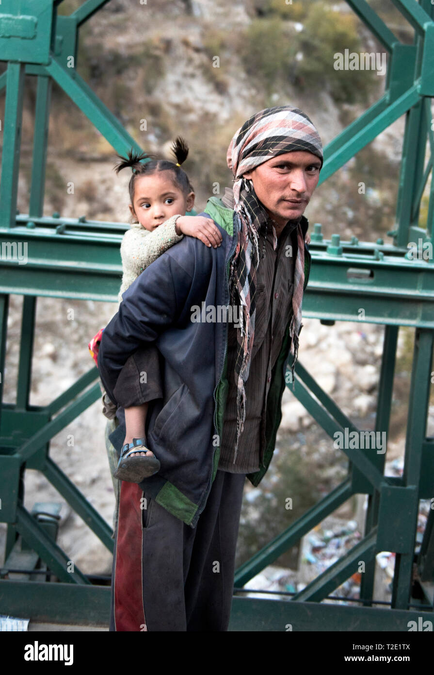 A man with his child in Himachal Pradesh, India - Stock Image
