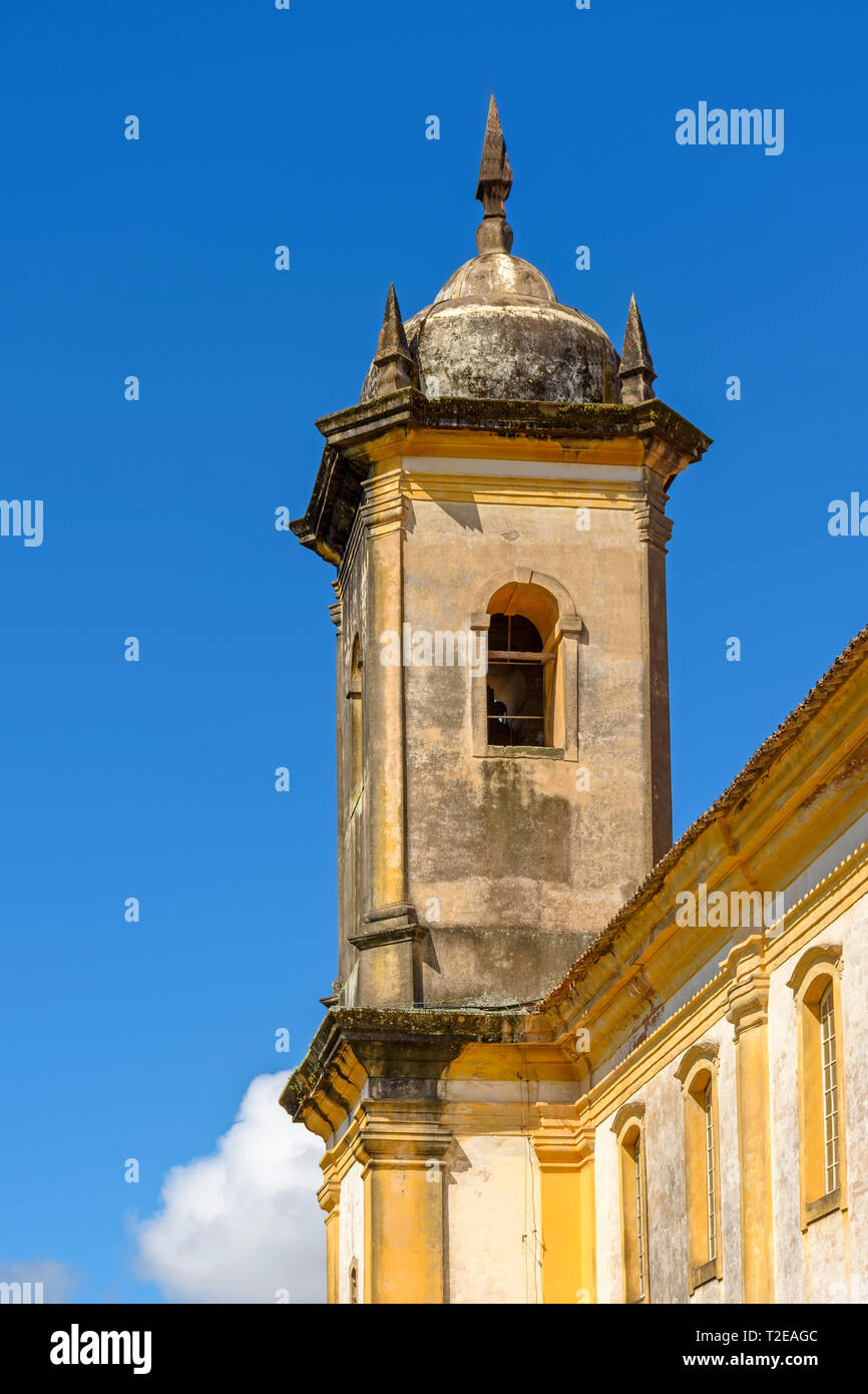 Old catholic baroque bell church tower of the 18th century located in the center of the famous and historical city of Ouro Preto in Minas Gerais - Stock Image