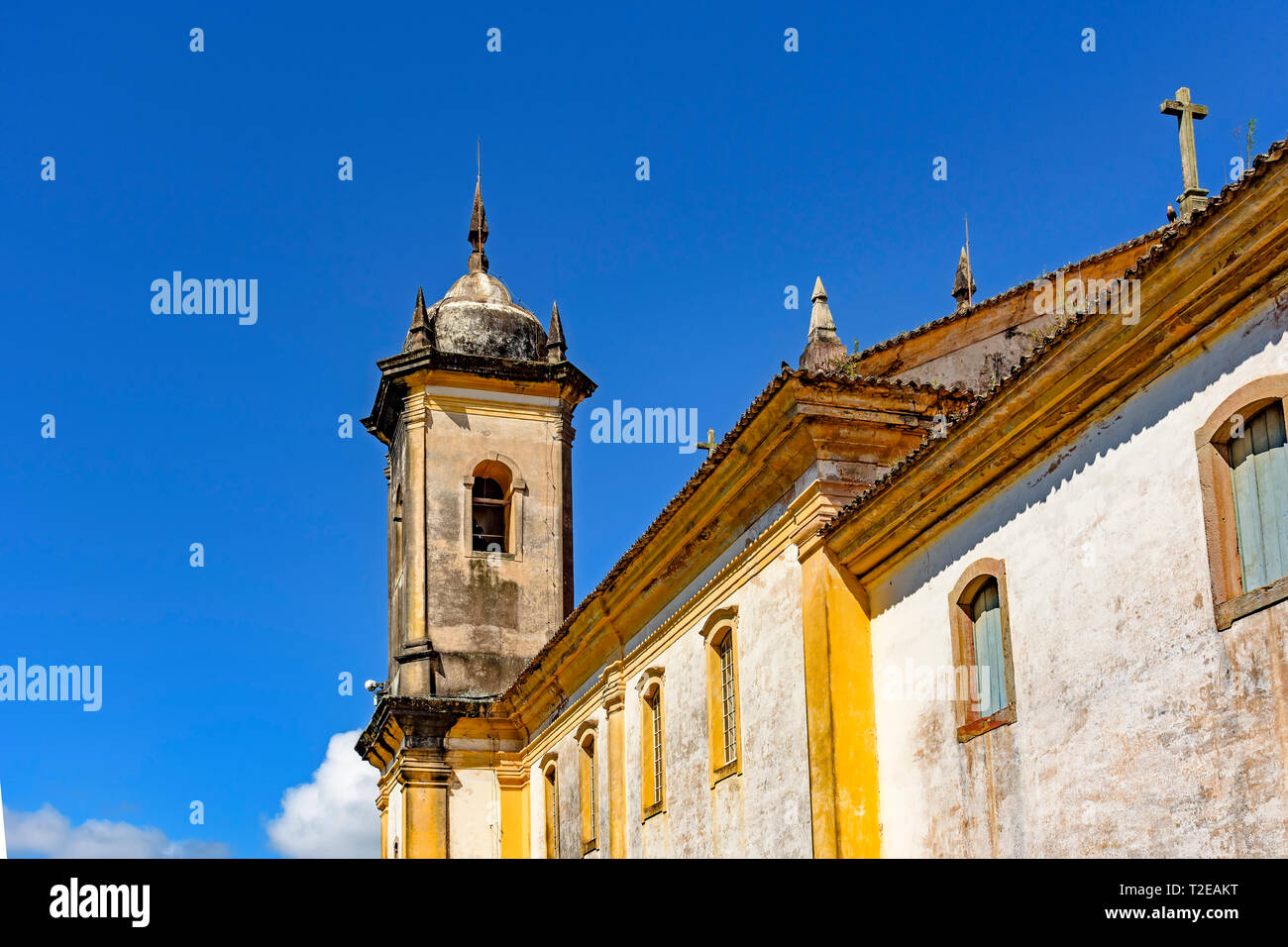 Old catholic bell church tower and facade of the 18th century located in the center of the famous and historical city of Ouro Preto in Minas Gerais - Stock Image