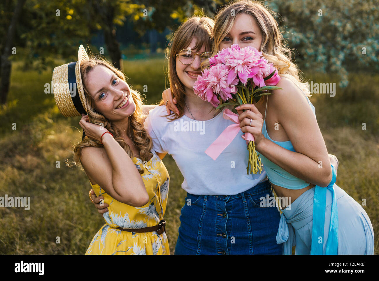Three girls friends outdoor in the park or forest. bachelorette, party Stock Photo