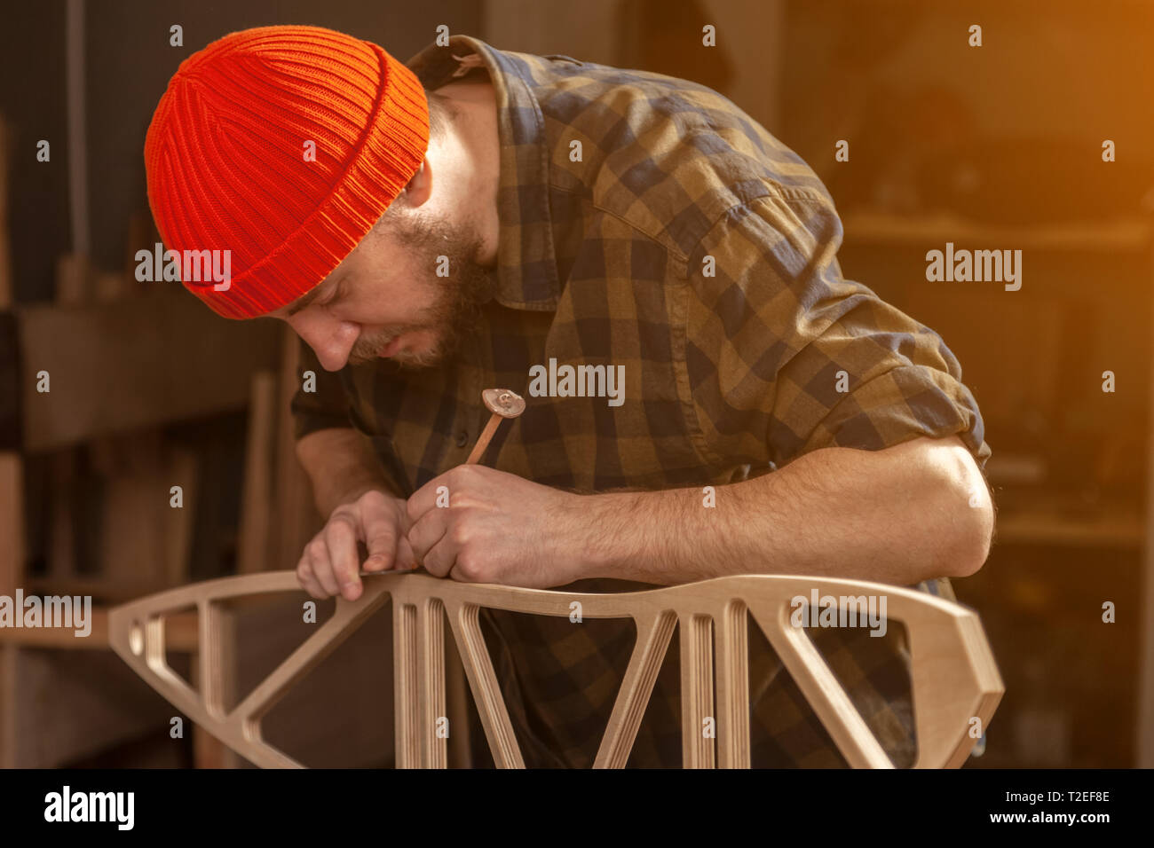 experienced carpenter in work clothes and small buiness